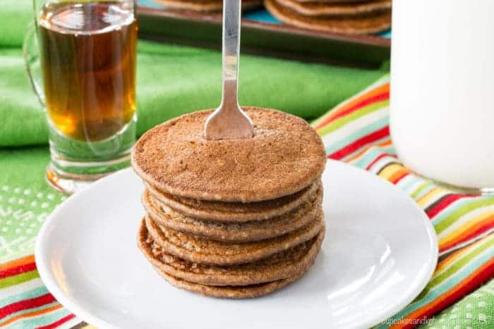 Gluten Free Chocolate Banana Oatmeal Pancakes on a white plate