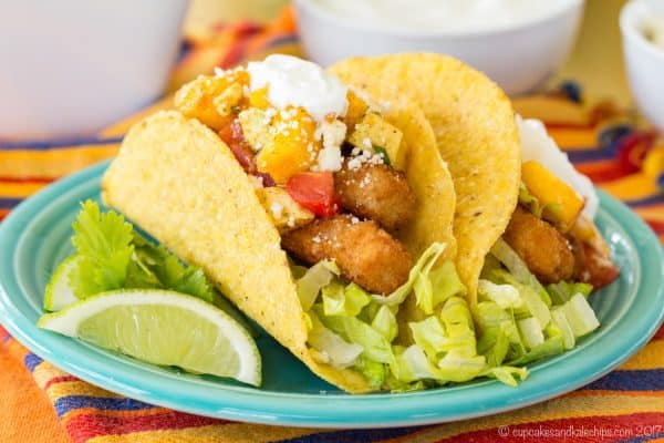 Chili Lime Fish Stick Tacos with Mango Avocado Salsa - an easy fish taco recipe with a trick to jazz up those fish sticks. #ad