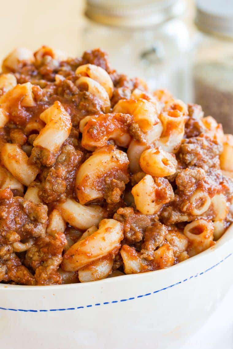 Closeup of ground beef and elbow macaroni with sauce in this beeferoni recipe