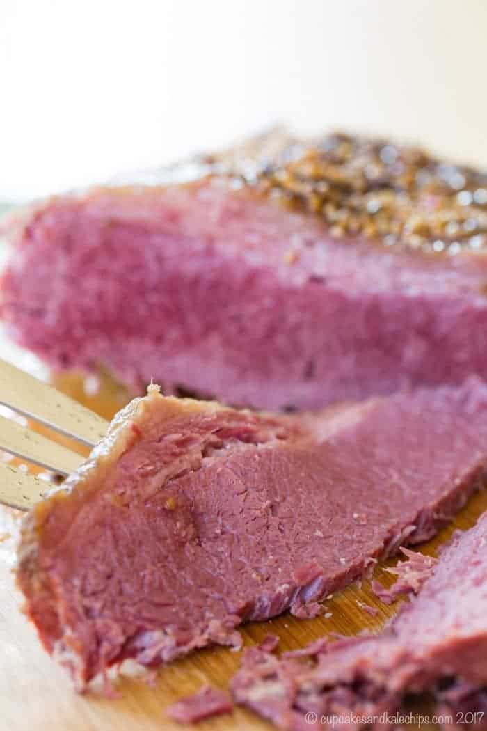 A fork with a slice of this gluten free corned beef recipe