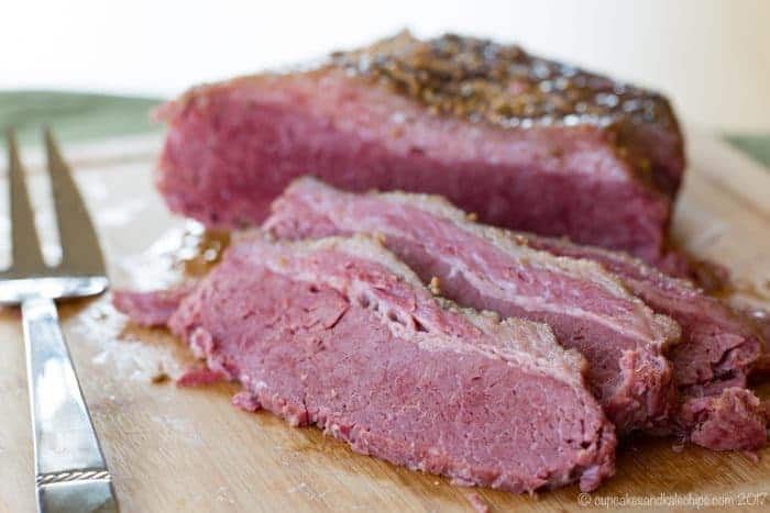 Easy Crock Pot Corned Beef Recipes for St. Patrick's Day on a cutting board