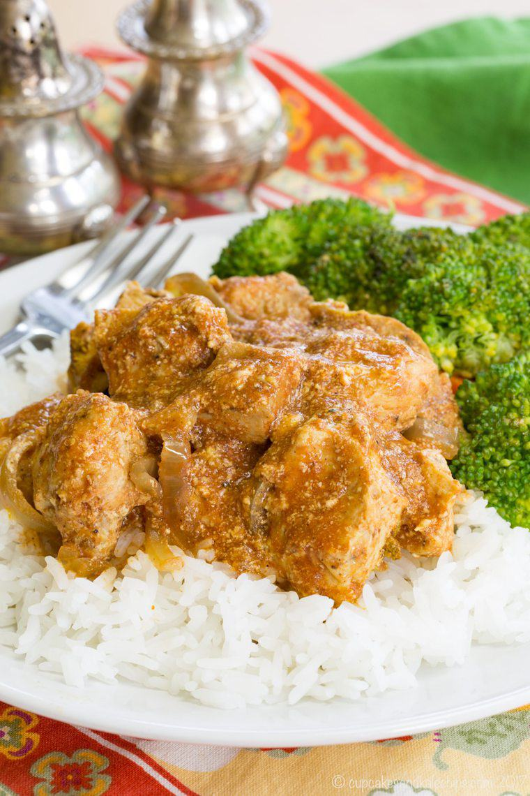 plate of healthy slow cooker butter chicken over rice