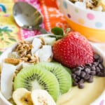 closeup of the toppings on a pineapple mango smoothie bowl