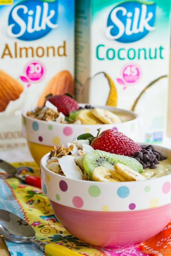 Mango Pineapple Tropical Smoothie Bowl - smooth and creamy with tasty toppings for a gluten free, dairy free breakfast or snack. Enjoy #plantbasedgoodness with @lovemysilk and #targetsmoothiebowls. #ad