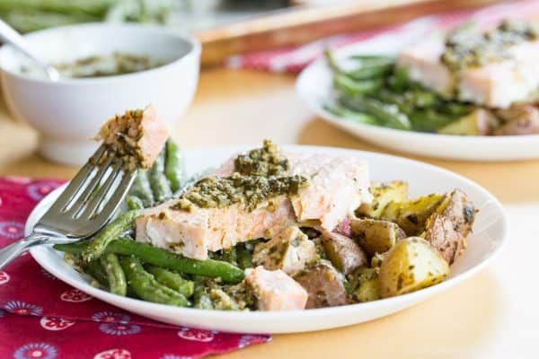 Pesto Salmon Sheet Pan Dinner with Potatoes and Green Beans - an easy dinner recipe that's ready in less than forty minutes with only one pan to clean up. This seafood sheet pan meal made with @GortonsSeafood is a healthy and gluten free addition to your weekly meal plan. #AD