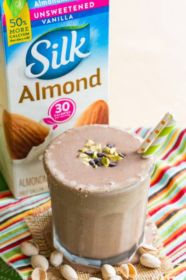 Banana Chocolate Pistachio Smoothie - a thick and chocolaty smoothie recipe. Everyone will love these delicious dairy free and vegan smoothies for breakfast, snack, or even dessert. So creamy because these #silksmoothies are made with @lovemysilk. #AD