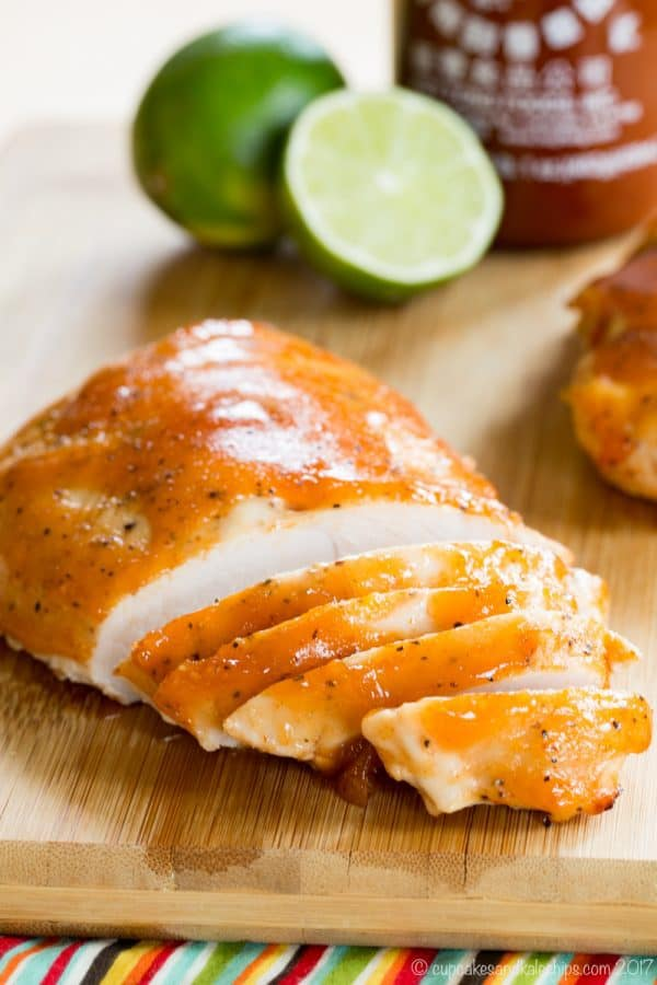 Sriracha Lime Slow Cooker Turkey Tenderloin on a cutting board with slices