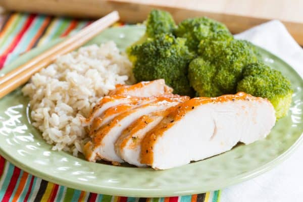 Sriracha Lime Crock Pot Turkey Tenderloin sliced on a plate with chopsticks