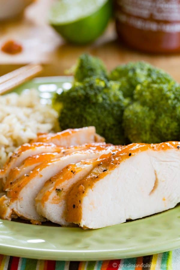 Slices of Crock Pot Turkey Tenderloin with Sriracha Lime Glaze on a green plate