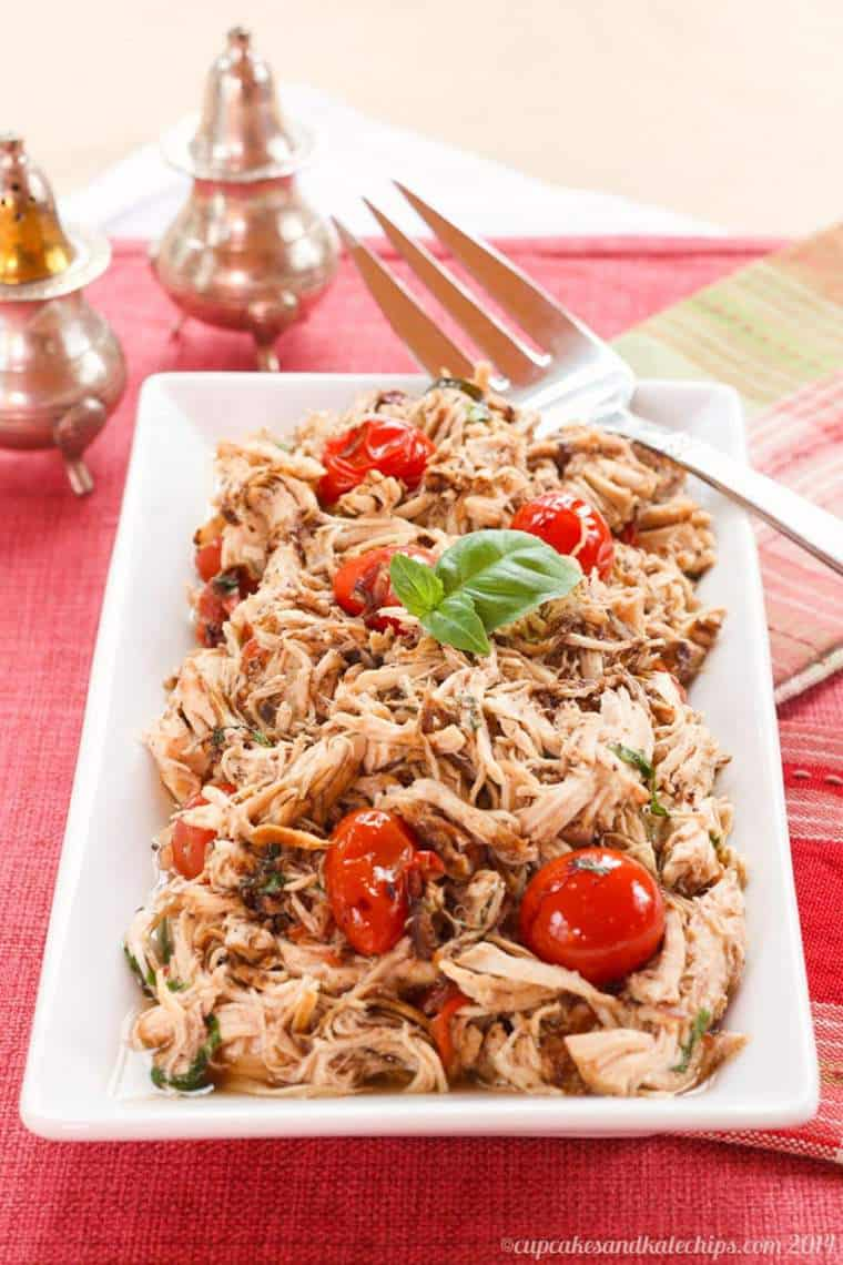 Tomato Basil Slow Cooker Pulled Chicken on a white plate