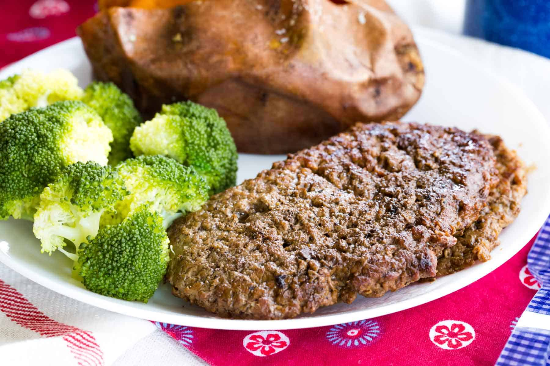 Worcestershire Sauce Cast Iron Cubed Steaks served with sweet potatoes and broccoli