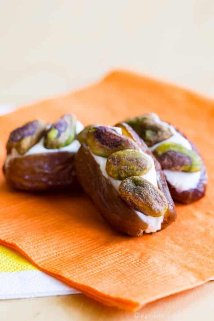 Dates Stuffed with Cream Cheese and Pistachios - an easy snack recipe with only three ingredients. Pack them in a lunchbox or serve on a fruit and cheese platter for a party appetizer.