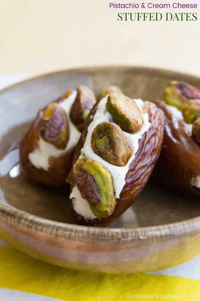 Pistachio Cream Cheese Stuffed Dates - an easy snack recipe with only three ingredients. Pack them in a lunchbox or serve on a fruit and cheese platter for a party appetizer.