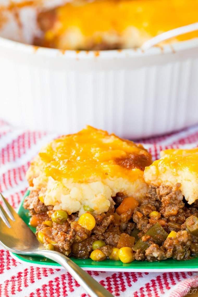 A scoop of Shepherds Pie on a green plate