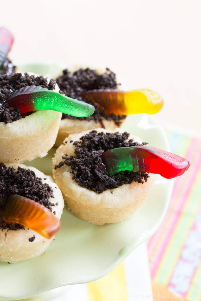 cookie cups filled with oreo dirt and gummy worms