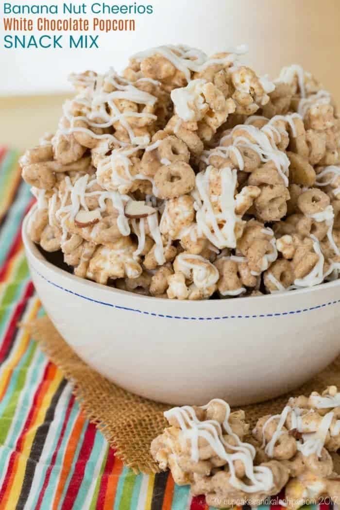 Banana Nut Cheerios White Chocolate Popcorn Snack Mix Recipe - an easy, six-ingredient snack recipe that's sweet and nutty with white chocolate, banana chips, and almond butter. #sponsored #glutenfree