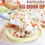 knife scooping up cheesy Kentucky Hot Brown Dip