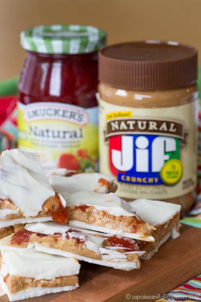 PB&J White Chocolate Bark - an easy holiday candy recipe stuffed with creamy Jif Peanut Butter filling and swirls of Smucker's Natural Strawberry Fruit Spread makes the perfect gift. Spread the #PBJLove this holiday season. #AD