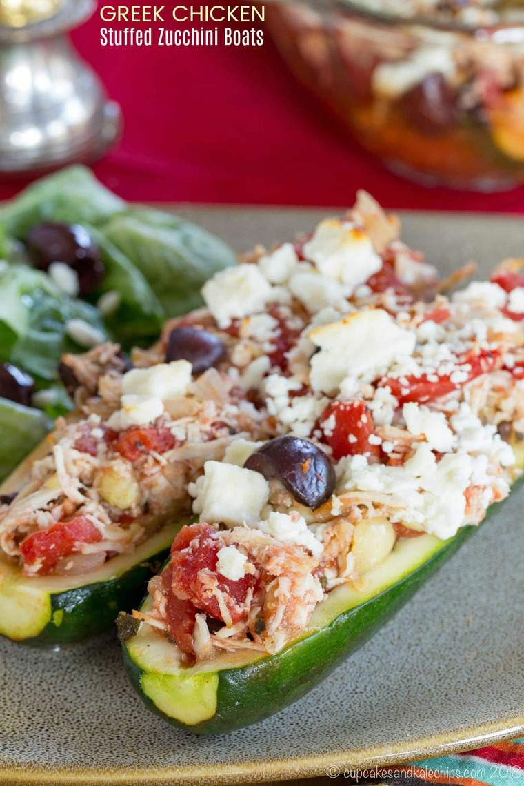 Greek Chicken Stuffed Zucchini Boats -  an easy low carb and gluten free dinner with with Mediterranean inspired flavors and ingredients including Kalamata olives, feta, oregano and @tuttorosso tomatoes. #AD #stuffedzucchini #zucchiniboats #chicken #chickenrecipe #glutenfree #lowcarb #mediterraneandiet #greekfood