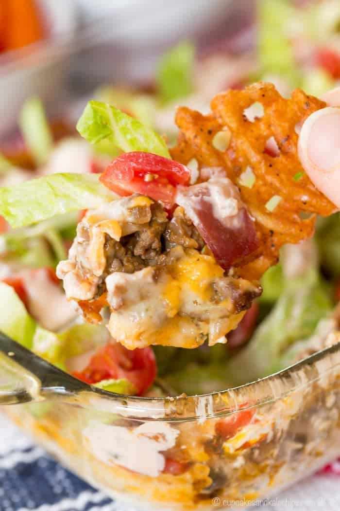 Closeup of Seven-Layer Bacon Cheeseburger Dip on a waffle fry