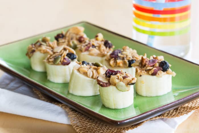 Easy Banana Snack Recipe with Peanut Butter and Granola on a green platter