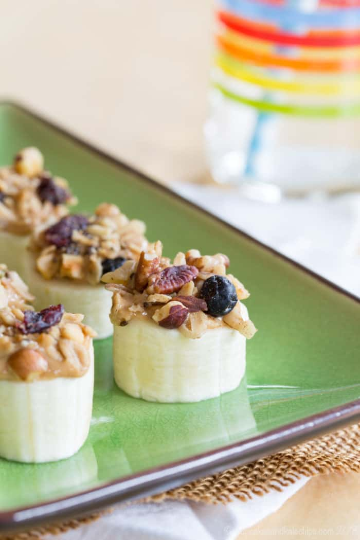 Closeup of one of these Healthy Peanut Butter Banana Snacks topped with granola