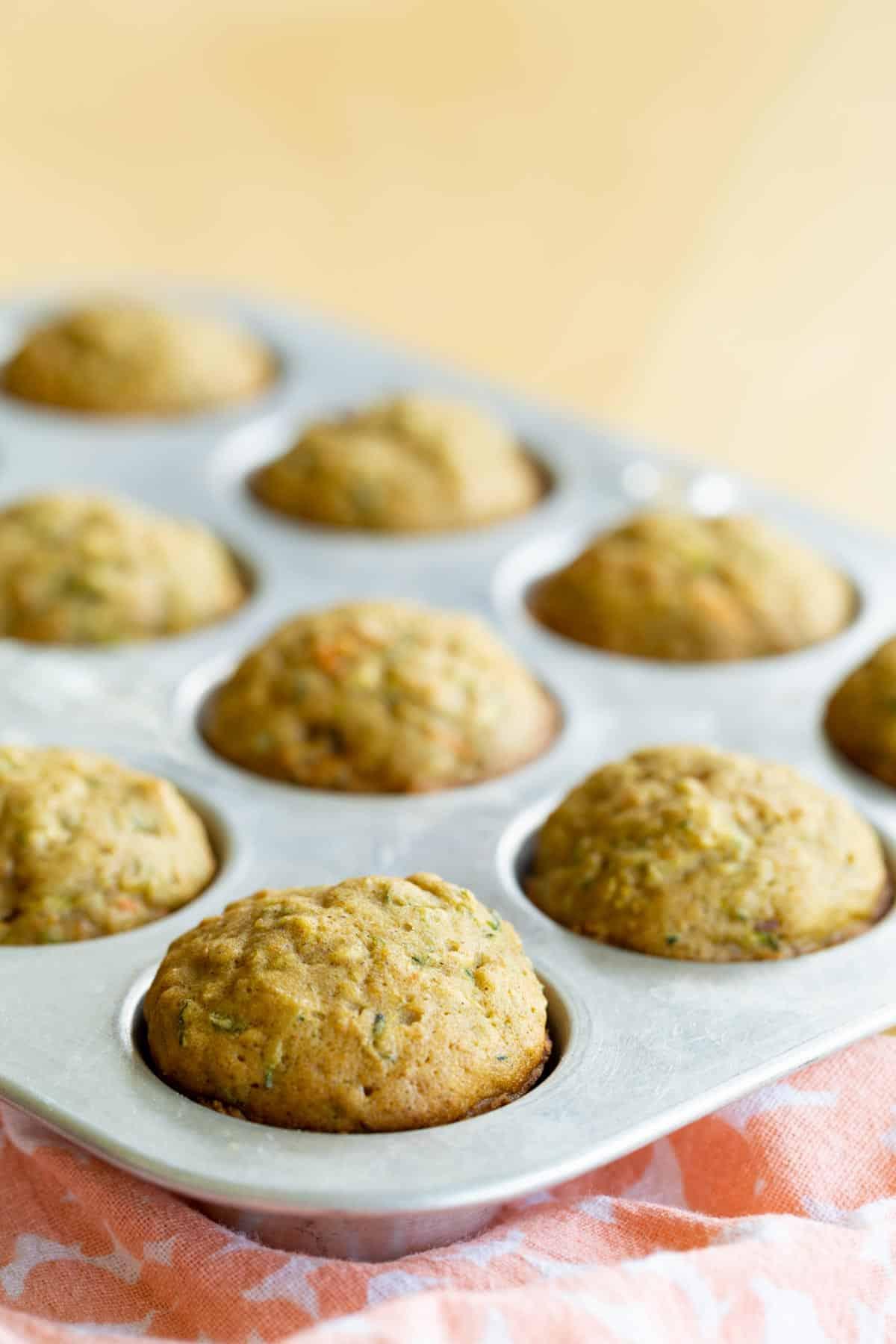 gluten free zucchini carrot muffins in a mini muffin tin