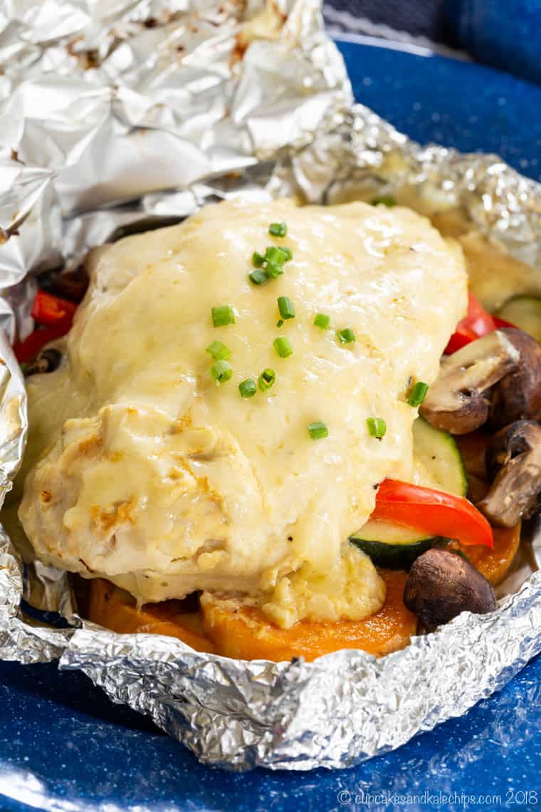 Closeup of Cheesy Maple Dijon Chicken Foil Packets with Veggies grilled or baked