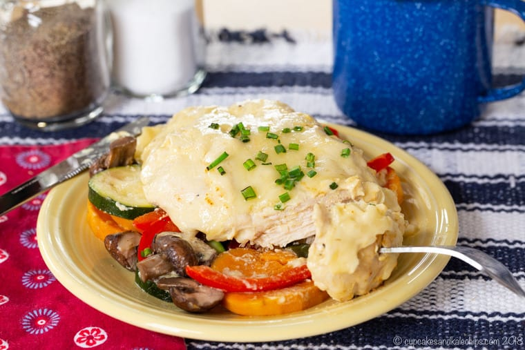 Cut into Cheesy Maple Dijon Chicken Foil Packets with Veggies