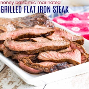 slices of Honey Balsamic Marinated Flat Iron Steak on a white plate