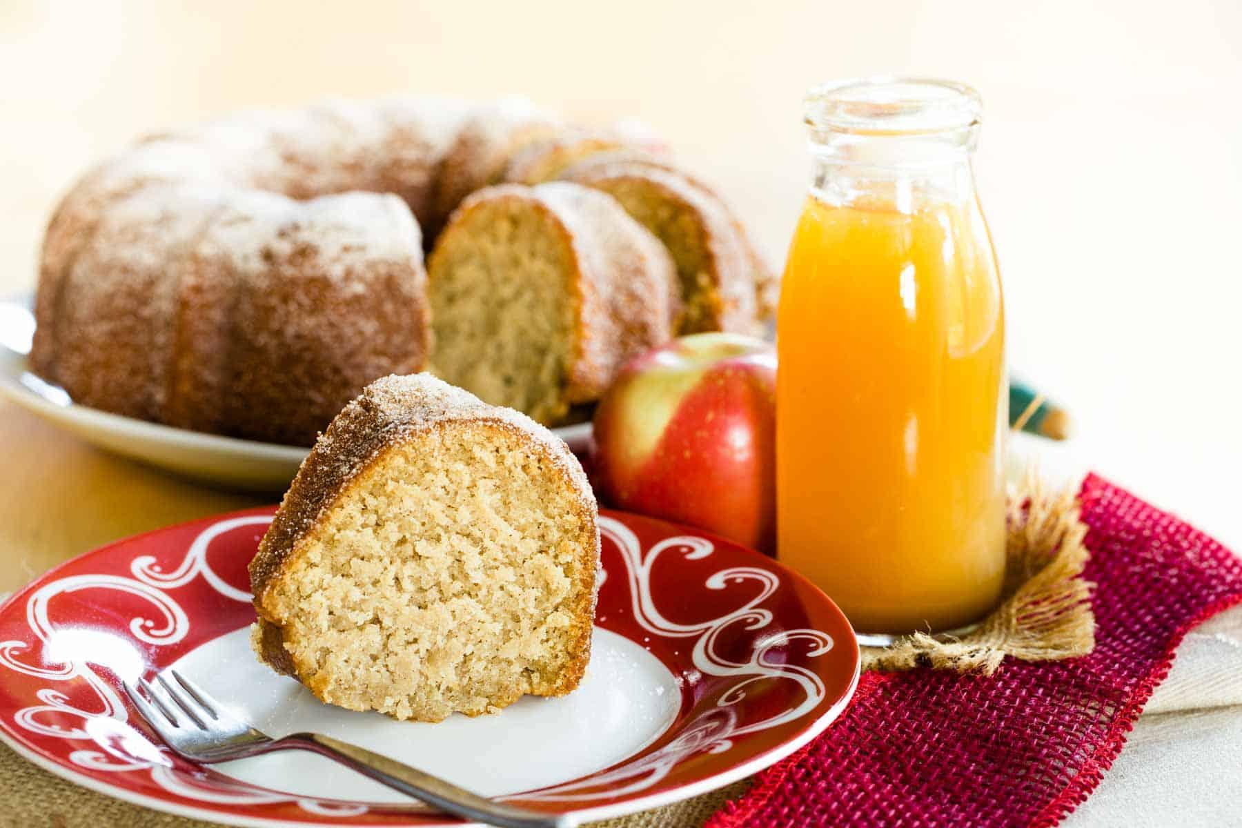 Gluten free apple cinnamon bundt cake with a slice in front