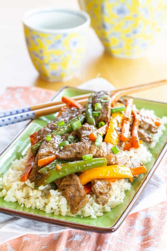 Gluten Free Beef Stir Fry over rice with chopsticks
