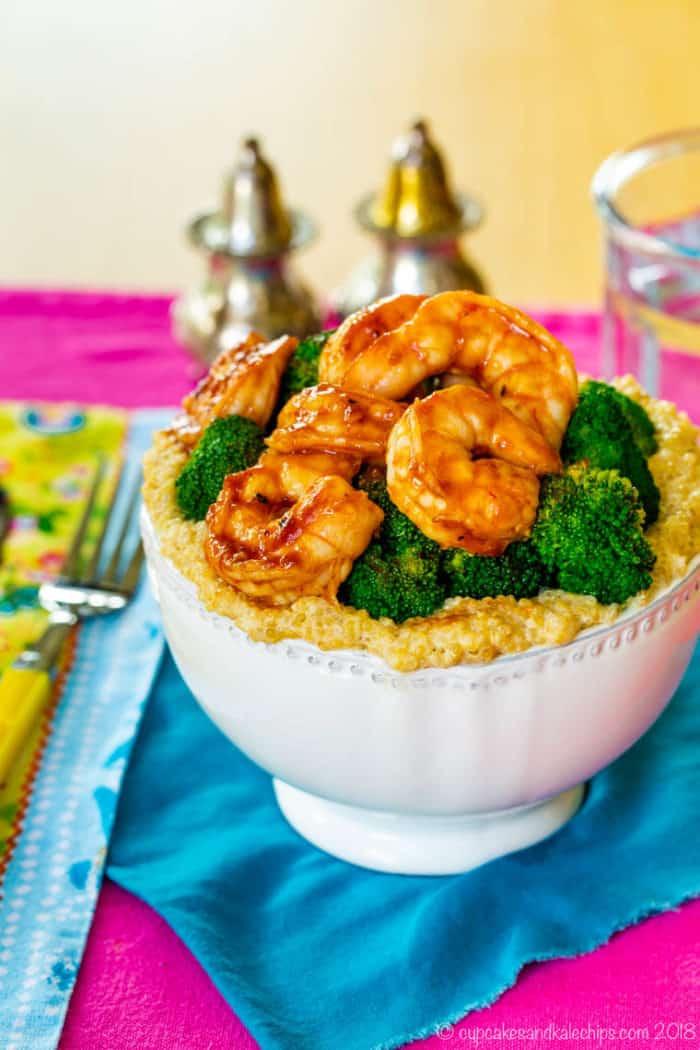 bowl of broccoli and BBQ shrimp over quinoa