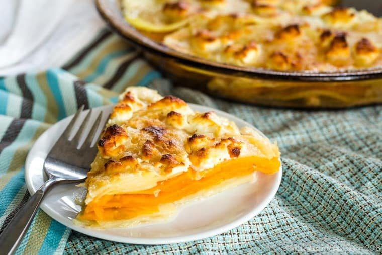 Slice of Goat Cheese Sweet Potato Gratin with a fork