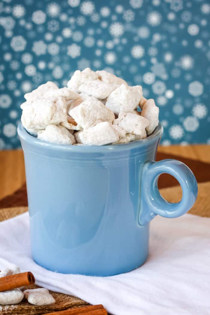 Chai Tea White Chocolate Puppy Chow in a blue mug