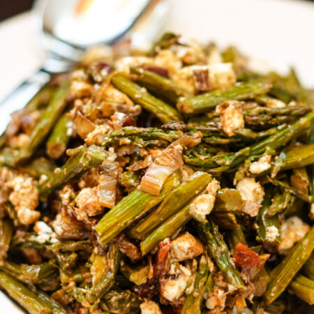 Closeup of Roasted Asparagus Salad with Caramelized Leek, Feta, and Dried Cherries