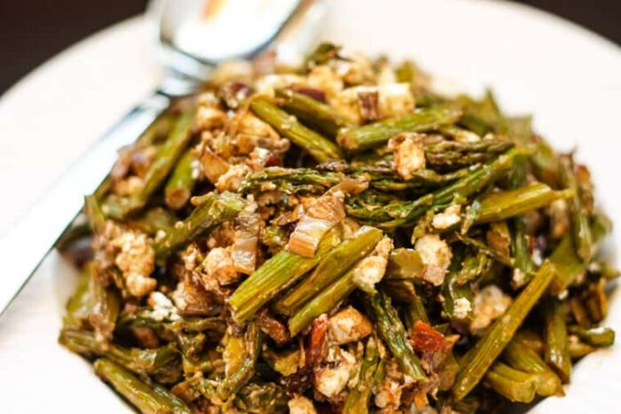 Closeup of Roasted Asparagus Salad with Caramelized Leek, Goat Cheese, and Dried Cherries