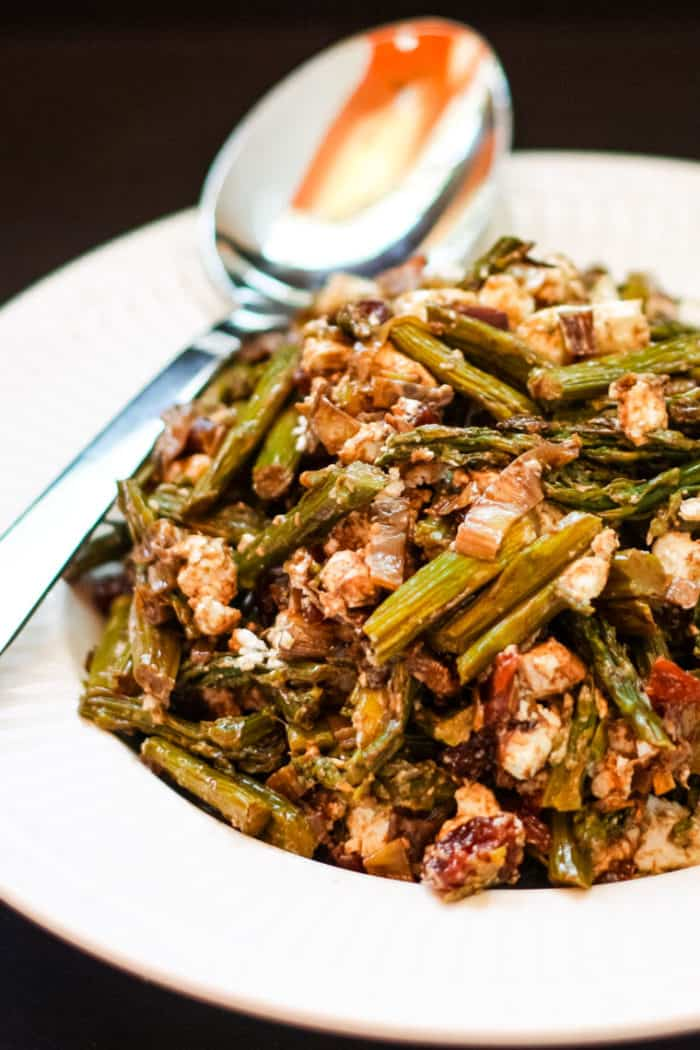 Caramelized Leek Asparagus Salad Recipe in a bowl with a spoon
