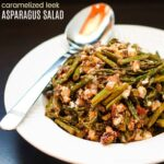 Caramelized Leek Asparagus Salad with a spoon and title for featured image