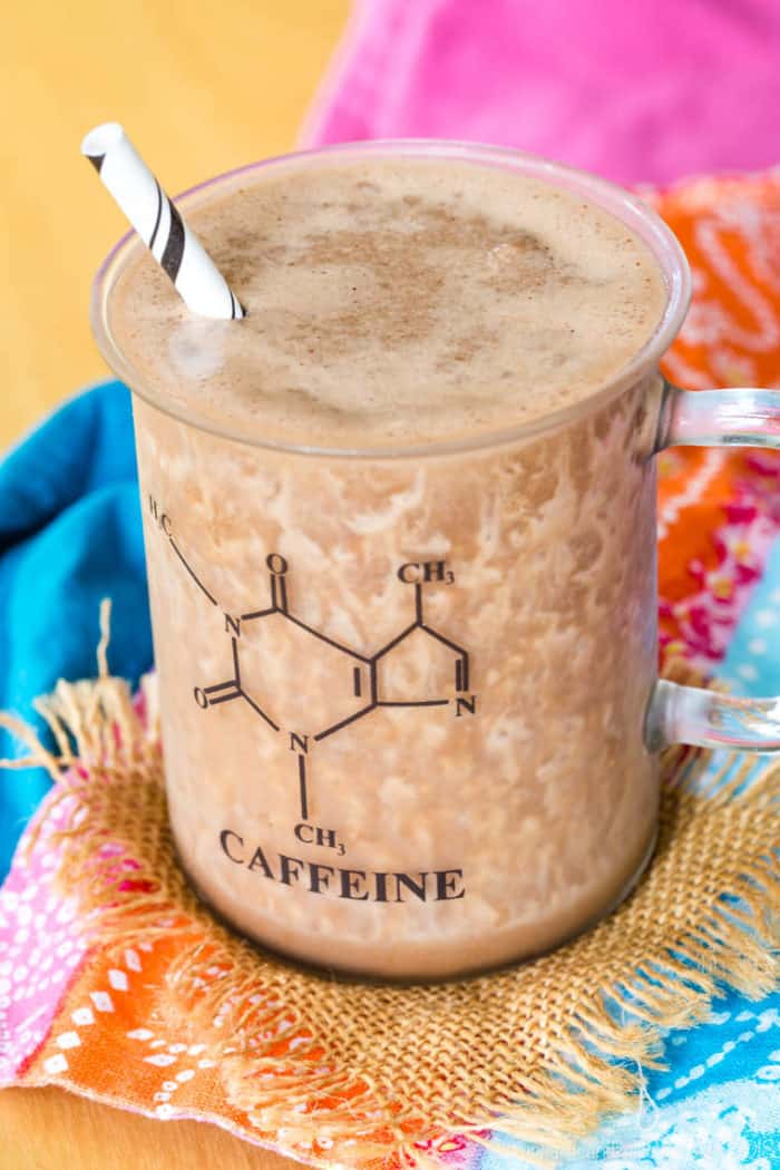 Chocolate Almond Protein Blended Cold Brew in a glass with the caffeine molecule on it