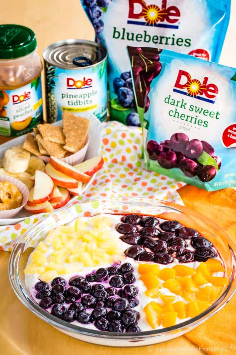 Greek Yogurt Cheesecake Fruit Dip with a selection of Dole Packaged Food frozen and canned fruit