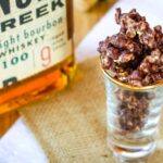 Bourbon Pecan Chocolate Popcorn in a shot glass