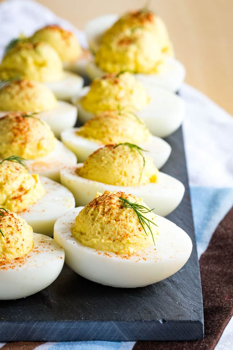 A row of Greek Yogurt Deviled Eggs without Mayo on a slate serving platter