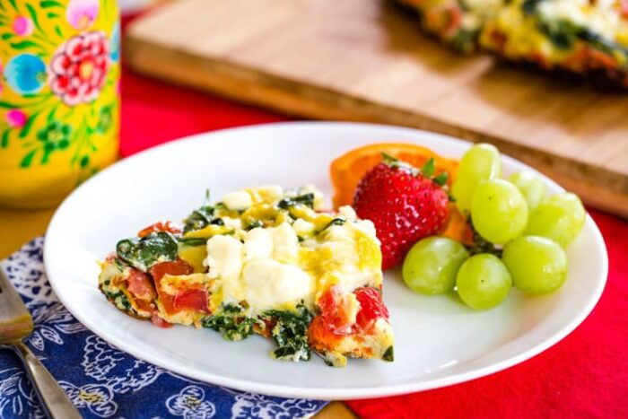 Tomato Feta Spinach Frittata served with fruit for brunch