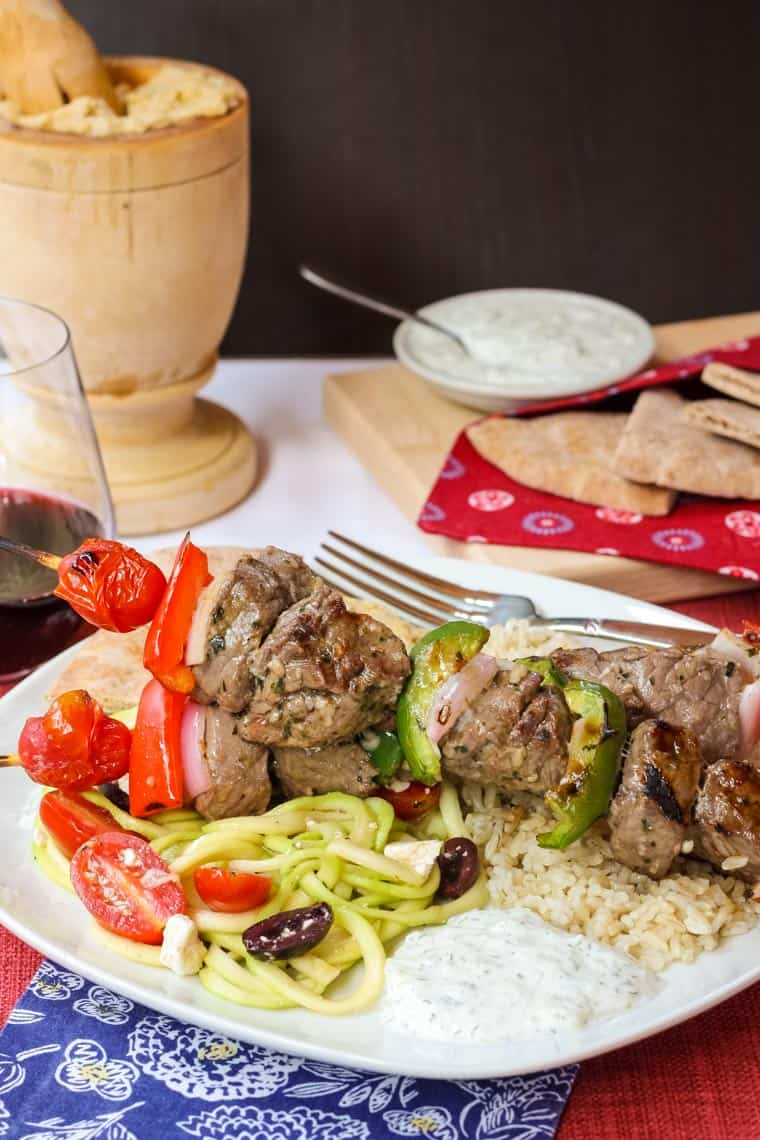 Grilled Greek Beef Kabobs for a Mediterranean dinner with rice, hummus, and tzatziki