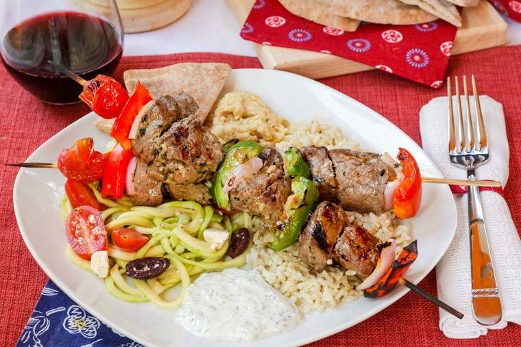 Greek Beef Kabobs with tzatziki, pita, rice, and zoodles Greek salad