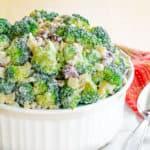 Healthy Apple Walnut Greek Yogurt Broccoli Salad in a white dish