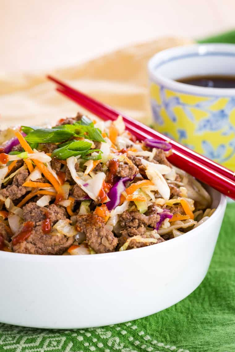 Healthy Egg Roll Bowl in a white bowl with red chopsticks