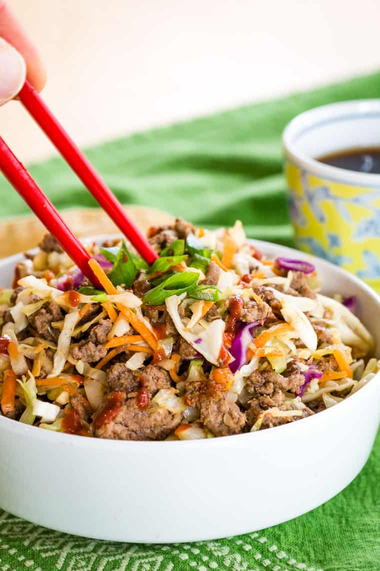 Eating low carb beef egg roll bowls with chop sticks