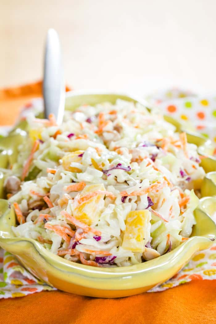 Healthy Pineapple Coleslaw in a yellow serving dish
